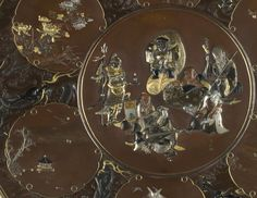 Inoue Company A superb inlaid bronze charger with a central panel decorated with the Seven Gods of Good Fortune delicately worked in honzogan and takazogan in gold, silver, copper, shakudo and shibuichi Signed Yukikazu with kakihan, the reverse with three seals, Kyoto, Inoue sei, Hiromasa Circa 1880 Dimensions (diameter): 61.0 cm