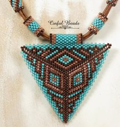 A very unique leather necklace that features a beautiful peyote stitched triangle pendant. The triangle is two dimensional. It puffs up slightly in the center. Its been beaded with Miyuki delicas using one of my favorite color combinations...dark copper, bright copper, and