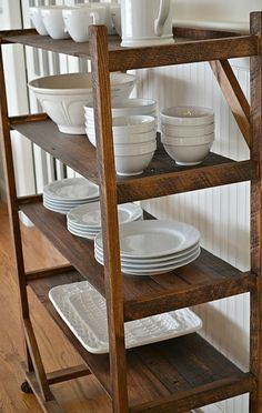 These old rolling shoe racks are great in almost any room! Kitchen, mudroom, entry, bathroom... We see them painted, bleached, original finish with stenciled compartments, etc.