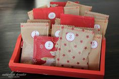 Easy advent calendar/packaging to make - just grab some paper, insert gift and sew it together (: