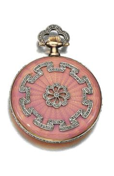 LADY'S ENAMEL AND DIAMOND WATCH, CARTIER, EARLY 20TH CENTURY The circular dial applied with Roman numerals and blued hands, decorated with light pink guilloché enamel applied with rose-cut diamonds, dial signed Cartier.