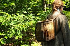 walking in the woods. Squam Lake. basket and wool sweater