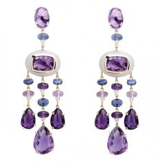 Fantastic glamorous purple earrings...how to make an impression with jewelry.