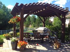Arched top solid wood pergola provides wonderful shade for family gatherings and barbecues.