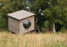 Six-sided modular cabin with wooden walls and fisheye windows