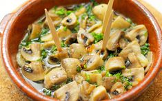 Mmmmm.... Take a look at this #Japanese take on the Spanish classic Champiñones Al Ajillo (Mushrooms in Garlicky Olive Oil)!! The mushrooms cook slowly, literally boiling in Olive Oil, instead of frying to infuse the garlic and mushroom flavors in the oil. Sop up with your favorite crusty bread. - Olive Oils from Spain