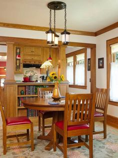 The dining room opens to the new, period-inspired kitchen. Separating the spaces is a new built-in bookcase on which pillars rest. Arts And Crafts House, Home Crafts, Craftsman Dining Room, Bedroom Photos, Built In Bookcase, Dining Room Furniture, Dining Rooms, Dining Chairs, Small Dining