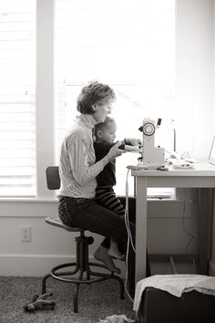 Grandma and granddaughter, sewing