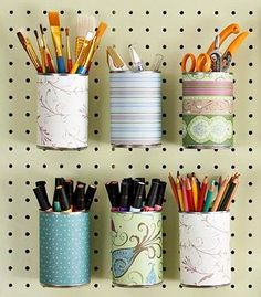 Scrapbook covered tin cans with hook in the back. Great for craft room Teacher Supply room or Makeup Area