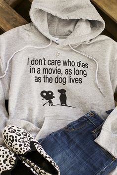 """Our hoodie has your sentiments for the most important character in the movie covered. Cozy cotton/poly blend and a unisex fit reads: """"I don't care who dies in a movie, as long as the dog lives."""""""