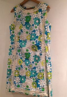 Vintage The Lilly dress by Lilly Pulitzer. I love the colors - turquoise, yellow and blue. Cheerful floral print too! Ebay $39, 11/14.