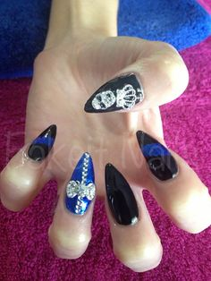 Stiletto acrylic nails with black & blue designs. Rhinestone detailing with 3d nail art! By fakeit nails :)