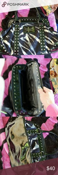 Betseyville zebra designed purse. Great condition. No flaws. Good size. Zip closure. 3 pockets inside with black satin interior Betsey Johnson Bags Satchels