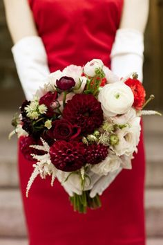 Red wedding dresses and bouquets for Christmas themed wedding ideas.