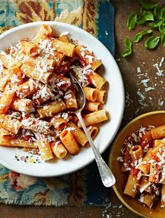 Rigatoni with roasted tomatoes & ricotta salata in a rich tomato sauce  This tomato sauce is cooked twice – once in the oven and once on the hob – for the best rich sauce that clings to the rigatoni