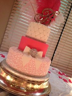 Girly cake!! Varied textures and silver stand. Note quilting and scroll work.
