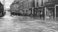 Old photograph of the 1910 flood in St Michael Street in Dumfries , Scotland . All photographs are copyright of Sandy Stevenson, Tour Sc. Michael Street, St Michael, Old Pictures, Old Photos, Old Photographs, Back In The Day, New York Skyline, Scotland, Saints