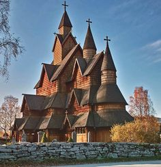 Heddal Stave Church. Telemark, Norway. Built in 1250. Steep-pitched wooden roofs, gables, towers. It has few small windows. [I love stave churches for the roof lines as well, they share the same interesting lines as gable roofs]
