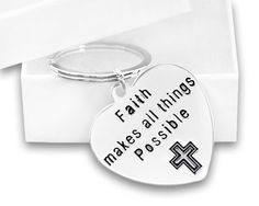 """Faith Makes All Things Possible Key Chain for Causes. Faith Makes All Things Possible Key Chain Sterling Silver Plated Key Chain  Reads: """" Faith Makes All Things Possible""""  Size: 1 1/2 inches x 1 1/2 inches  This key chain can come in a gift box This key chain can be used for any cause, and for any reason. Faith does make all things possible.  This sterling silver plated key chain is a large heart that has the words """"Faith Makes All Things Possible"""". The heart is approximately 1 1/2 inches…"""