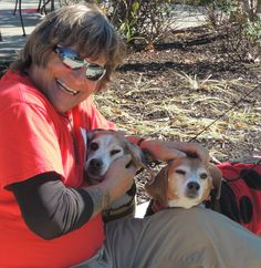 Volunteer Boyd with two SPCA adoptables Marcie & Snoopy at the Barktoberfest at the Green Turtle in Annapolis