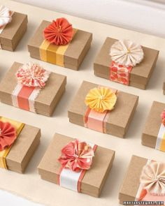 Wrap small boxes with a belt of layered ribbons or a strip of woven fabric, & cap it off with a single fabric blossom.