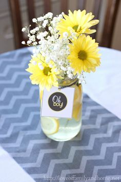 Gray and yellow baby shower decorations on a budget. Lots of decorating ideas for throwing a baby shower without spending a lot of money. Deco Baby Shower, Baby Shower Yellow, Baby Yellow, Baby Boy Shower, Yellow Theme, Baby Party, Baby Shower Parties, Baby Shower Themes, Mesas Para Baby Shower