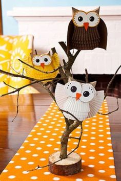 Owls made out of cupcake liners and craft paper would be cute in yellow ,gray, and aqua and put in branches just like this.
