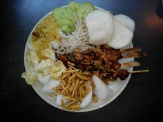 Saté Madura, from Madura Indonesia, served with green beans, beansprouts, lontong, prawncrackers, cumcumber, fried spiced coconut with peanuts, mellindonut crackers, peanutsauce, & sambal kecap(spicey soyasauce) ...