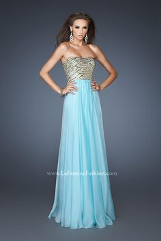 Interesting top on this prom dress. My girl always loves some blue.