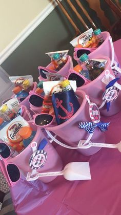 "Favors for the bridesmaids at my sisters ""Last Sail before the Veil"" bachelorette party. Included were mini wine bottles, bottles of Gatorade which I had removed the labels from and wrapped with nautical printed duct tape, Advil packets, some snack size chocolates, gum, and bags of goldfish. Also included were pink sunglasses that I wrote ""Get Nauti"" on the side of with a navy blue acrylic paint pen. I made the ""Bride's Mate"" buttons myself with some supplies I found online. Huge success!!"
