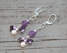 Here's my latest semi-precious Faceted Amethyst Earrings, with Amethyst Nuggets, Lavender Potato Pearls, White Circlé Pearls, Silver Plated (SP) Oval Chain and SP Leverback Earwires.  For details about these handmade earrings or to purchase them, click on the Etsy link below.  Faceted Amethyst Amethyst Nuggets Lavender by AdornmentsByEloise, $18.00    Thanks for browsing, and come back again! Eloise