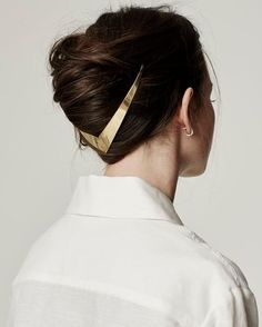 Take a step into the future with this sleek metal halo hair accessory.