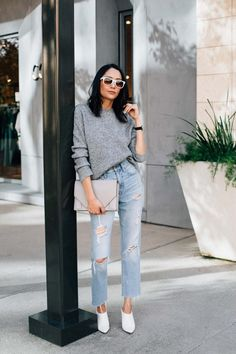 Lilly Beltran of Daily Craving in vintage denim & oversized grey sweater with white shoes for a casual fall outfit