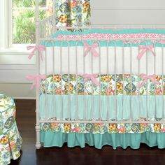 Teal Flower Garden Crib Bedding   Carousel Designs.  Beautiful hues of aqua, teal and turquoise with a hint of coral combine to create this unique crib bedding collection. Its easy to mix and match your favorite crib sheets with the fabulous triple tier skirt in shades of teals.