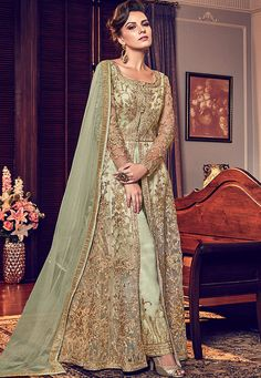 Light Green Embroidered Wedding Anarkali Lehenga/Pant Suit features embroidery work with minimalist modern art detail annotated beautifully with the combination of resham zari, thread and stone wor. Abaya Fashion, Fashion Pants, Indian Fashion, Fashion Dresses, Anarkali Lehenga, Anarkali Suits, Saree, Indian Dresses, Indian Outfits