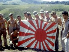 American Soldiers Holding Captured Japanese Flag on Guadalcanal Island During WWII