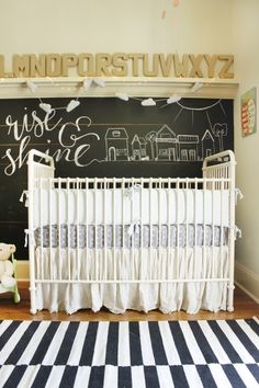 Chalkboard accent wall with alphabet in this school-house inspired nursery - we're in love!