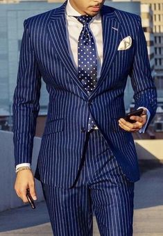 Let or design team at Giorgenti New York design your very own custom tailored blue pinstripe suit with white pocket square and tie. Come see us in our private Long Island showroom today for your mens style consultation. Der Gentleman, Gentleman Style, Mens Fashion Suits, Mens Suits, Mode Costume, Designer Suits For Men, Suit And Tie, Well Dressed Men, Stylish Men