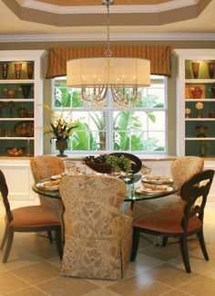 Antique Chandelier above dining room table in traditional style home