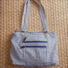 White And Blue Striped Canvas Bag Large Worn White And Blue Striped Canvas Bag Large. Has signs of wear and has a mark on the bottom as pictured Bags