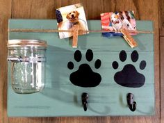 Distressed dog treat and leash holder. Allows you to personalize it on your own (with photos and chalkboard paws)! Perfect to hang on the wall in any room! Makes for a great gift! FEATURES: 1) Dimensions are approximately 16 x 10.5 2) Constructed from 3/4 pine (good quality, very sturdy) 3) Pint-sized, wide-mouth mason jar with lid (treats not included) 4) Comes with piece of chalk to personalize on your own. 5) Please specify leash hook finish (black or matte nickel)...we will choose f...