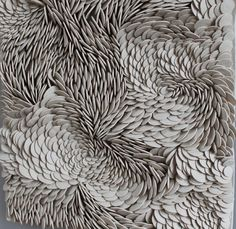 British artist Fenella Elms creates ceramic artworks that are comprised of intricate, meticulously-placed porcelain beads.
