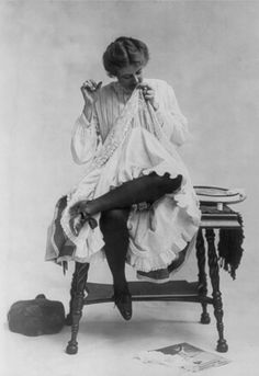 vintage sewing photo c.1900   (I am sure showing this much leg..all the way to the knee...was extremely naughty...even covered by a stocking oh my)