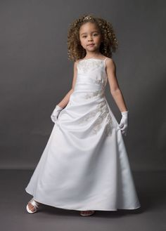 David's Bridal flower girl dress. I like this because my dress has beaded lace too!
