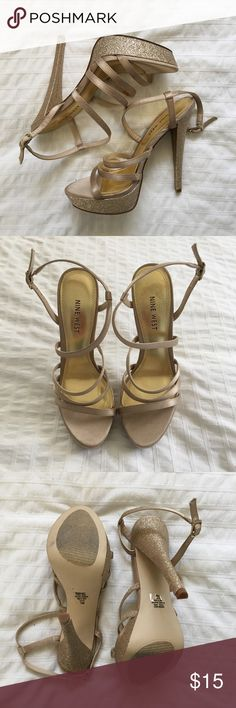 """✨ Nine West Arm Candy Heels - Gold GORGEOUS gold glitter strappy heels, the pictures do not do them justice. These are beautiful, and will be the star of the show at any event. ✨ Worn only once, still in EXCELLENT condition.  👠Materials Textile Upper • Balance Manmade   📏Measurements 7M • 6"""" Heel • 1"""" Platform  🌟Bundle 2 or more items and save!  📸 Follow me on Instagram @cubbycreekboutique Nine West Shoes Heels"""