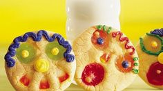 """Kids will have great fun both making and eating these zany cookie faces """"finger-painted"""" with colorful candies."""