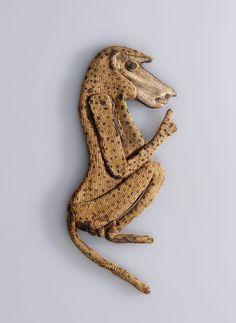 Baboon Appliqué from an Animal Mummy. Possibly from Saqqara, Egypt. Ptolemaic Period, 305–30 B.C.E. Linen, 51/2 x 23/8 in. (14.2 x 5.6 cm). Brooklyn Museum; Charles Edwin Wilbour Fund, 37.272E. (Photo: Gavin Ashworth, Brooklyn Museum)