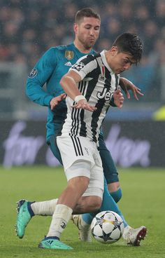 Paulo Dybala (front) of Juventus FC is challenged by Sergio Ramos of Real Madrid during the UEFA Champions League Quarter Final Leg One match between Juventus and Real Madrid at Allianz Stadium on April 3, 2018 in Turin, Italy.
