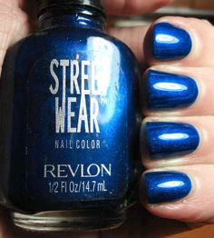 Revlon Street Wear- Midnight. Same thing, bottle that has Revlon on it is a bright metallic blue, the one that doesn't say Revlon on it but has the same name is a dark glittery blue.