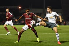 Ander Herrera of Manchester United and Kenji Gorre of Northampton Town in action…